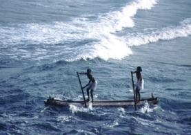 Keralan fisherfolk on a Katumarran in normal conditions